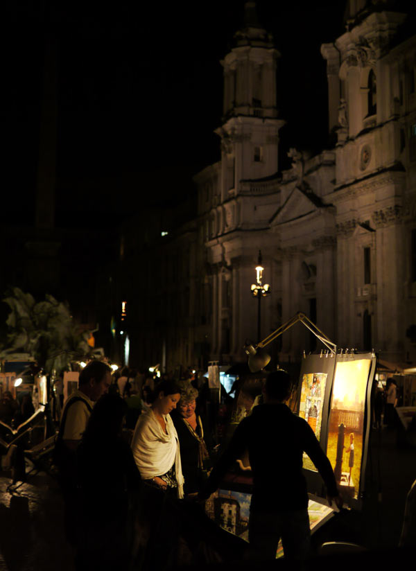 Selling paintings at night in Piazza Navona